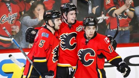 Monahan's 4-point night leads Flames past Hurricanes