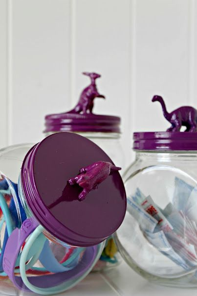 Give your kids bathroom decor an easy update. Make these cute DIY Dinosaur Topped Jars for storage of bandages, hair accessories and more.