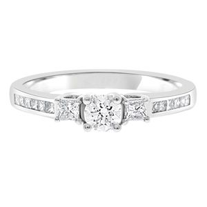 0.50ct Channel Set Trilogy Ring T004 with a round brilliant cut diamond and two princess cut diamonds,
