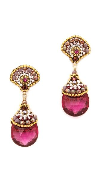 Gold-plated rondelle beads and quartz stones cap dangling Swarovski crystals on decadent Miguel Ases earrings. Post closure.  14k gold fill. Made in the USA.  Measurements Length: 1.5in / 4cm $256.00  14k gold fil...