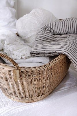 Basket full of bedding...yes I have a big oval basket I will place near iron bed filled with beautiful crocheted pillowcases, throws, and 2nd. set of sheets. Pretty to look at and pretty handy.