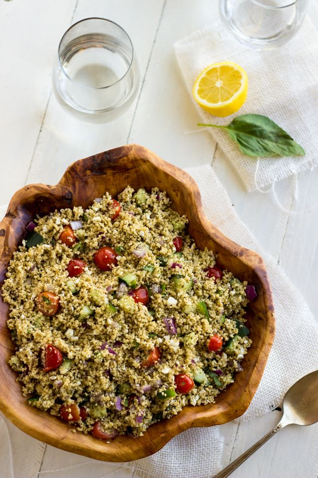 Mediterranean Couscous Salad - A quick, and easy salad that is light and healthy! It's always a crowd pleaser! | Foodfaithfitness.com | #recipe