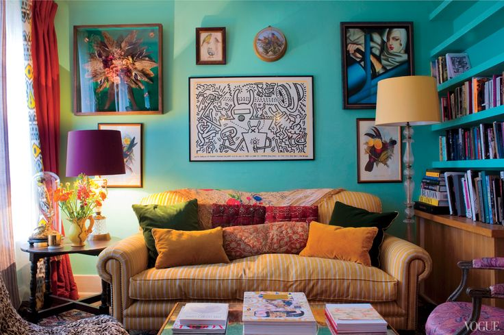 The Avian-themed living room also features a Keith Haring poster, a family heirloom. Pictured: (from center to top right) Keith Haring Artwork  Haring Foundation; Tamara De Lempicka/Tamara Art Heritage/ADAGP, Paris/ARS, NY.
