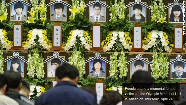 People pay tribute to victims at a memorial altar in Ansan, South Korea. CNN