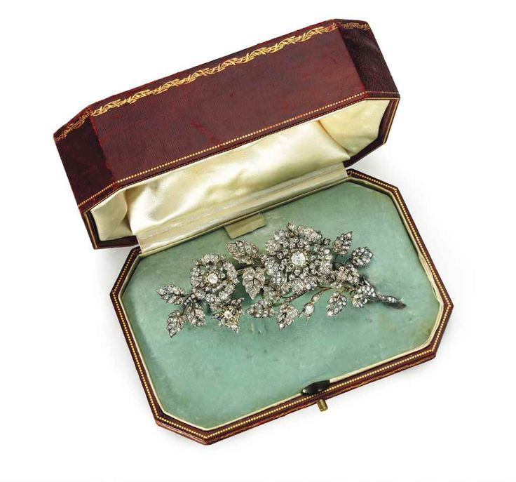 AN ANTIQUE DIAMOND BROOCH The old and rose-cut diamond floral cascade set en-tremblant, circa 1895, 4 7/8 ins., mounted in silver-topped gold, in a fitted maroon leather case