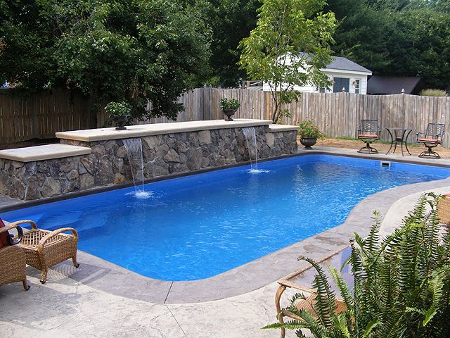 Rock Wall Water Feature Along The Back Of The Pool Great
