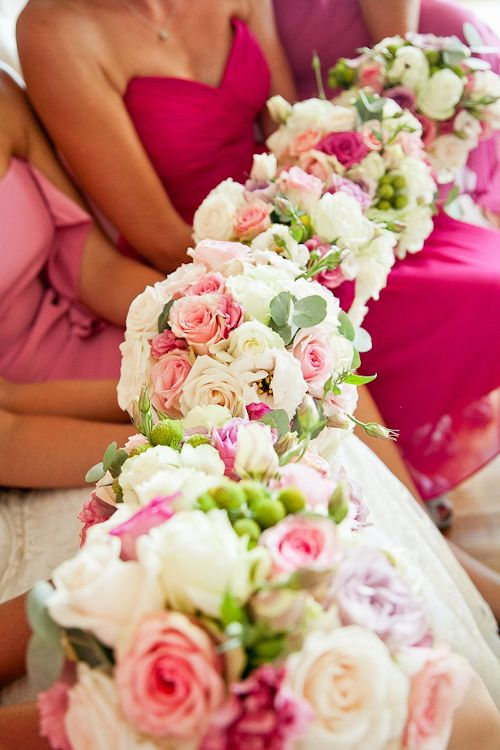 Hot pink bridesmaid dresses with soft pink bouquets - photo by Du Wayne Photography