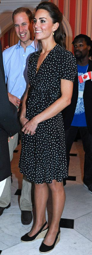 Duchess of Cambridge Kate attends a youth barbecue and reception at the Government House in Ottawa sporting Issa bird print dress