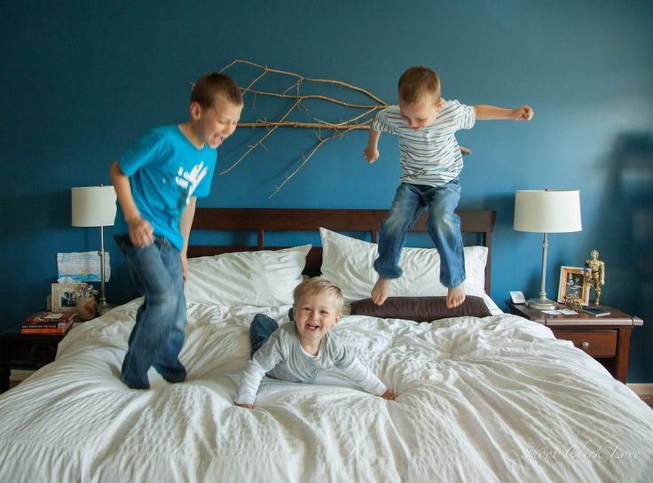 Jumping on the bed is a perfect sensory diet activity. Get 100+ ideas here
