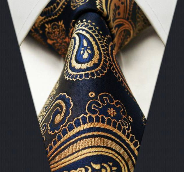 "Product number: PA-5757 Length: 59"" Width: 3.5"" Material: 100% Silk Care: Dry Clean Only Label: GENTLEMAN JOE This shimmering navy, gold, bronze, copper paisley tie is truly a work of art! Every angle"