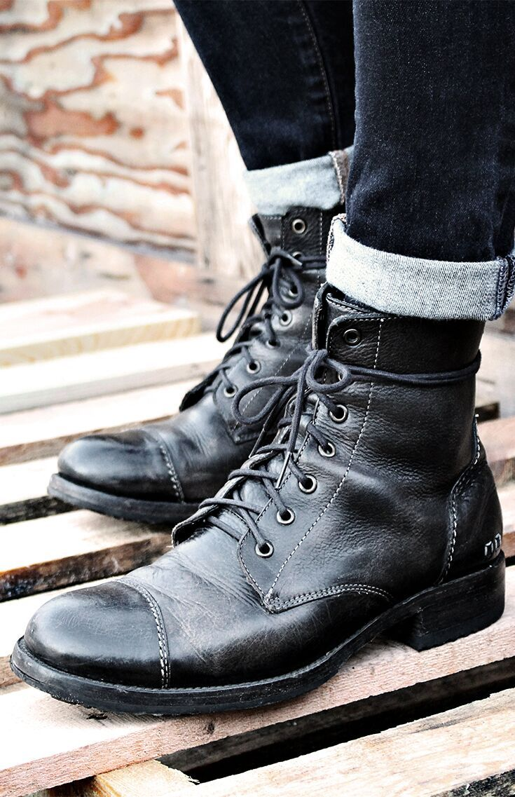 Black leather lace up boot by BEDSTU. This easy on combat boot features a back zipper. Wear with rolled denim at the top for an edgy look.