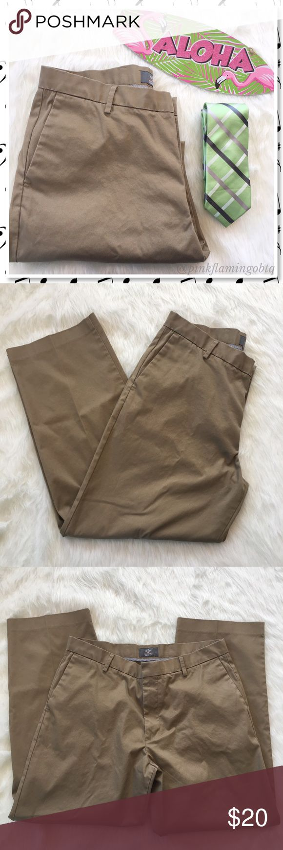Dockers Classic Fit Iron Free Khaki Pants 🌀HP🌀 Mens classic Dockers khaki pants. Classic fit, iron free and flat front. Closet staple that is so easy to maintain. Wear with a polo or button down shirt. Great used condition size 36x30. Issac Mizrahi tie not included for styling purposes only. Dockers Pants Chinos & Khakis