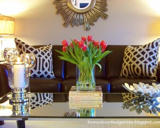 patterned pillows on brown couch, coffee table decor