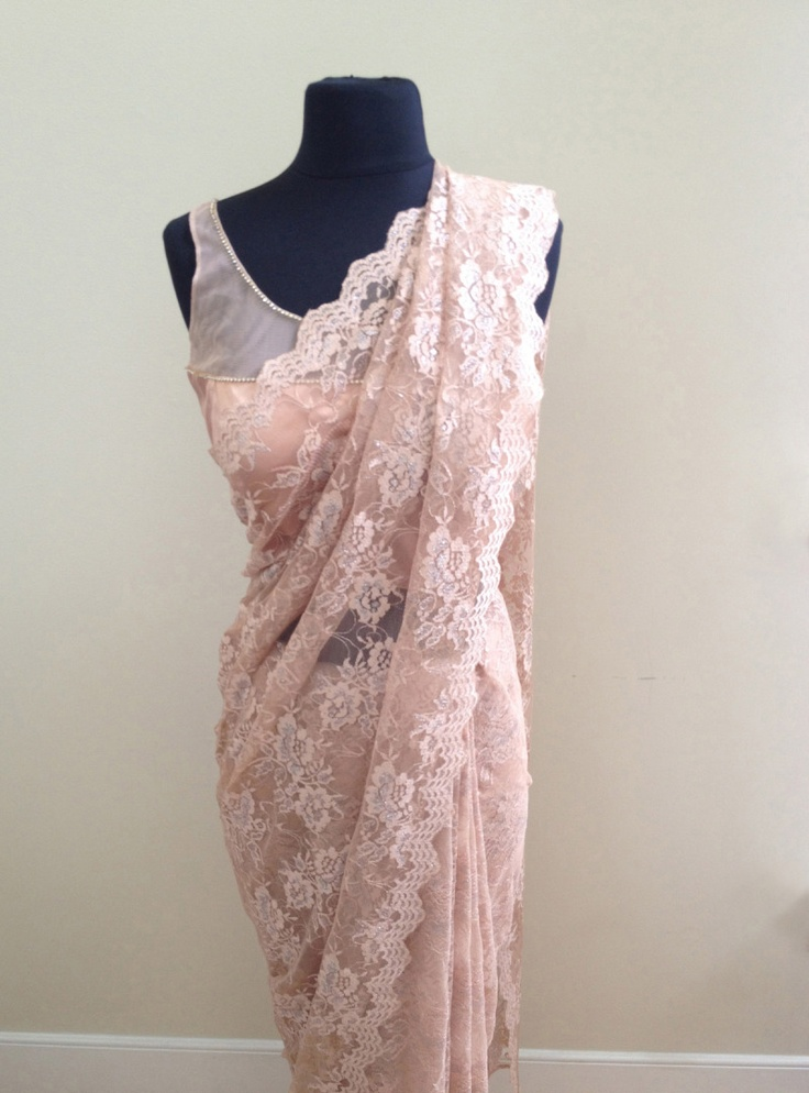 scalloped edge beige lace saree