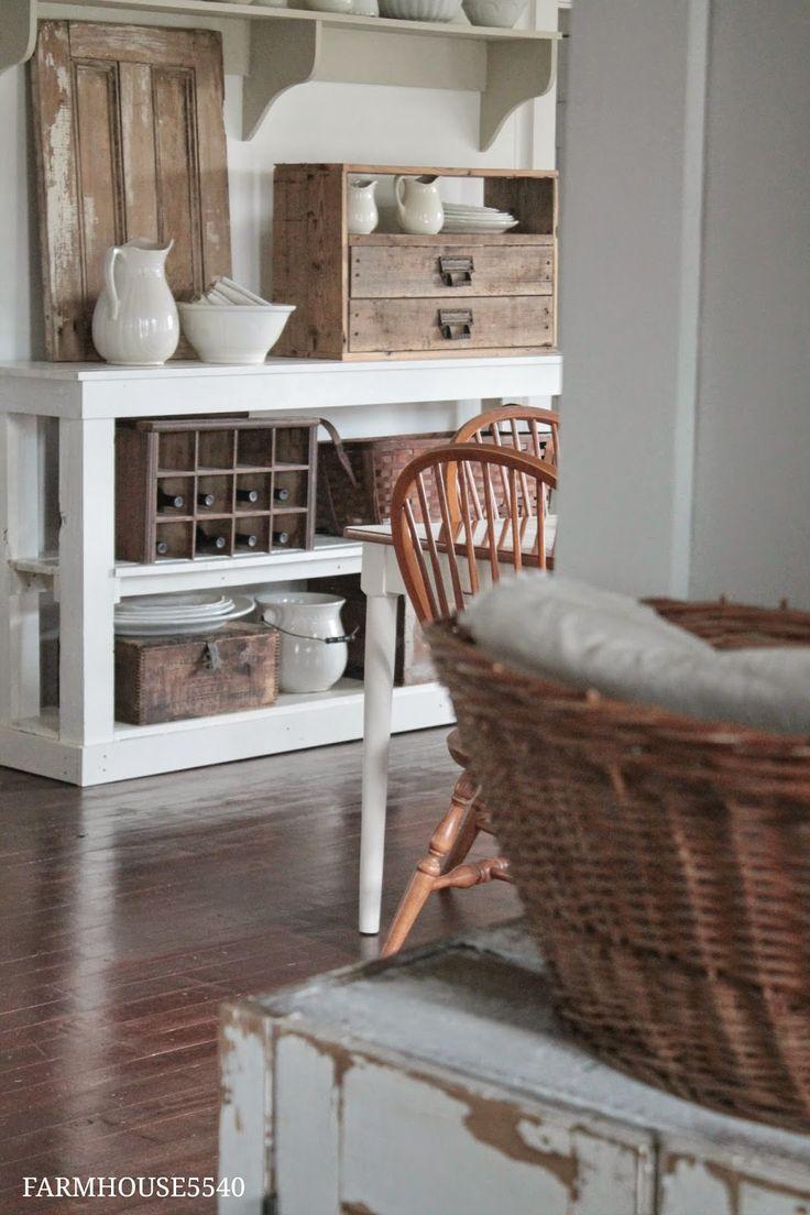 Primitive Decorating - vintage baskets and boxes are used for storage - via FARMHOUSE 5540: Farmhouse Friday ~ Farmhouse Storage