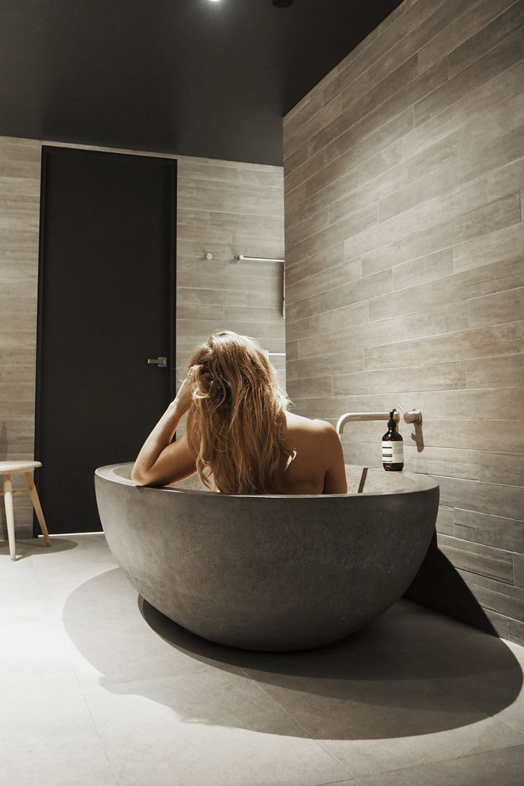 Travel blogger Lisa Hamilton from See Want Shop relaxing in a bathtub