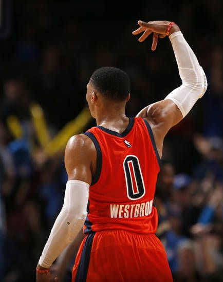 Oklahoma City's Russell Westbrook (0) shoots a 3-point defends late in the fourth quarter during the NBA game between the Oklahoma City Thunder and the New Orleans Pelicans at the Chesapeake Energy Arena, Sunday, Dec. 4, 2016. Photo by Sarah Phipps, The Oklahoman