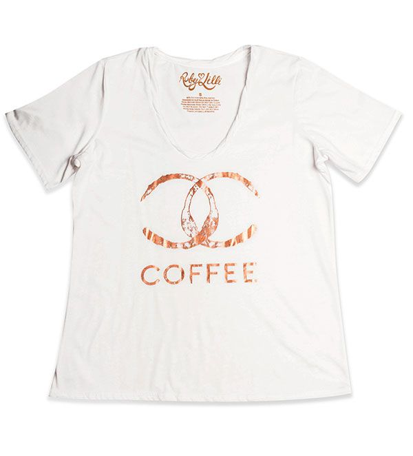 Coffee is the elixir of life.     Celebrate your love of coffee with our gorgeous Coffee Tee. The stunning Bronze Foil on Cream is as luxurious as the aroma of coffee in the morning.  Crème  Bronze Foil Print  Vintage Feel Cotton Blend  Round Neckline  Relaxed Fit  RubyLilli_coffee  Size S (10) to 5X (26)