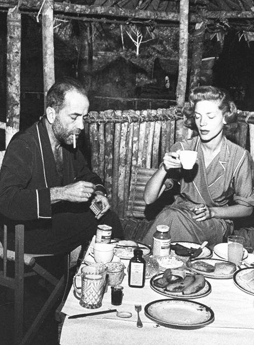 Humphrey Bogart and Lauren Bacall having breakfast on the set of 'The African Queen'