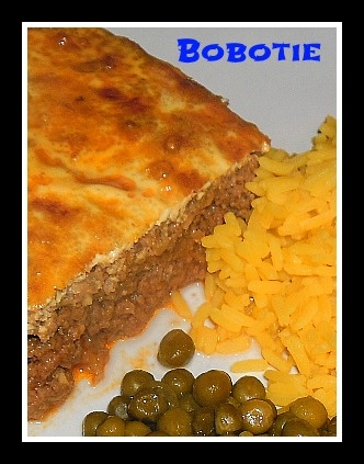 "Bobtie (South African Dish): ""I do not think there is a more traditional South-African classic dish as Bobotie. It is usually served with yellow rice (spicy or not, with raisins or without)"""