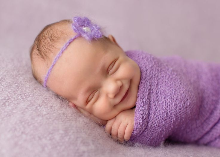 Perfectly timed photos capture a newborn's smile