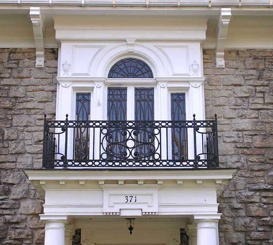 Palladian window: A three part window featuring a large arched center and flanking rectangular sidelights.