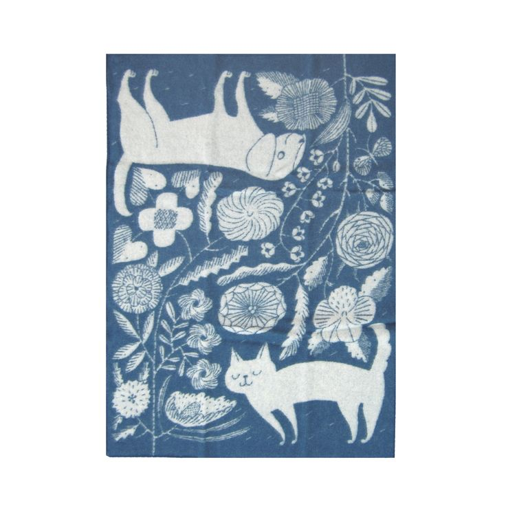 """When it's raining or snowing cats and dogs, the Lapuan Kankurit Koira ja Kissa Wool Blanket is just the right size for wrapping your lap or for keeping beloved furry friends cozy. Makoto Kagoshima's """"K"""