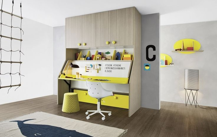 Tippy bridging unit in cenere finish with limone-coloured Woody knobs, drop-down bed with Graphic panel and desk in limone finish. #nidi #nididesign #kids #hanging #kidsroom #room #fun #colors #furniture #design