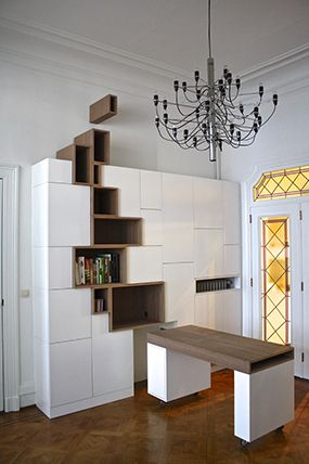 Built in cupboard with white lacquer and walnut, combination of open and closed storage and pull out table