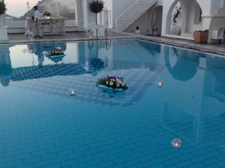 Flower arrangements with floating candles pool decoration!