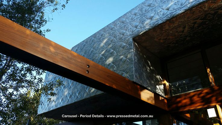Carousel Pressed Metal panels in the 6ft x 3ft format have been used to clad the exterior of this home.