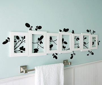 paint/stencil a design on the wall or use a decal, then add empty picture frames randomly for visual interest. So easy & cute!!