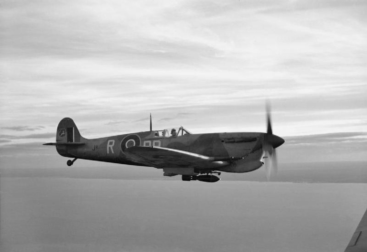 Supermarine Spitfire Mark VC, JK--- 'DB-R', of No. 2 Squadron SAAF based at Palata, Italy, carrying a 250-lb GP bomb beneath the fuselage, in flight along the Adriatic Coast while on a bombing mission to the Sangro River battlefront. Note the badge of No. 7 Wing SAAF, a leaping hartebeest on a red shield, painted on the rudder of the aircraft