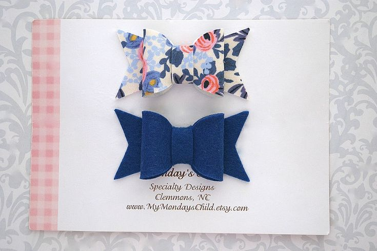 These pretty bows are made of fabric and wool felt. They measure 2.5 inches wide and are attached to ribbon lined alligator clips. The pretty fabric is from the Rifle Paper Company and is called Rosa in periwinkle. The designer fabric has been backed with premium merino wool felt for