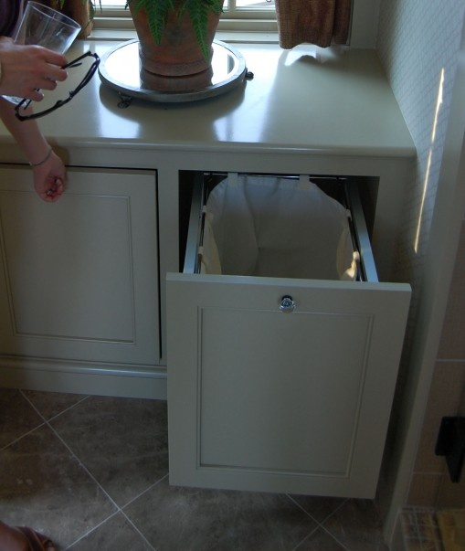 built-in laundry cabinets in the bathroom