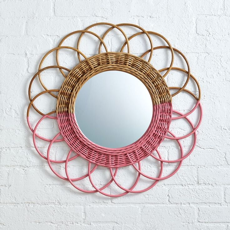 """You'll definitely want to say """"good morning"""" to our pink Sunrise Rattan Mirror…"""