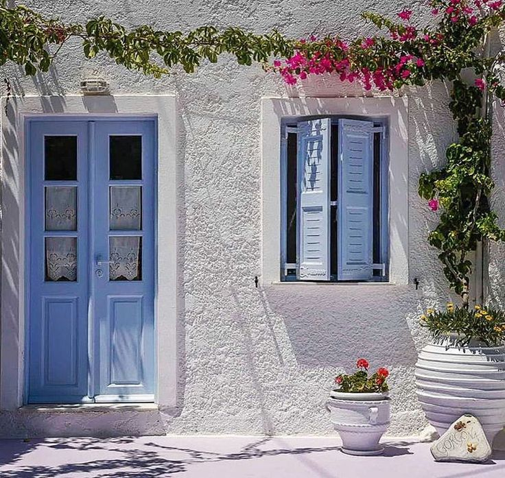 island of ios (Ίος) Colorful flowers on the white wall ❤
