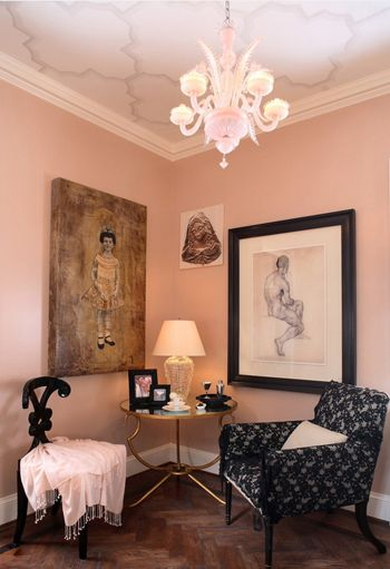 soft pink sitting area, wood floors, black painted chair with off-white throw, white accents, black accents (Sherwin Williams, Lotus Flower)