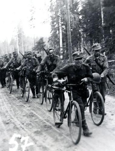 Finnish bicycle battalion advancing towards Tolvajärvi, early at 4:37 in the morning of July 13, 1941.