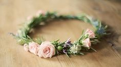 Nikki's flower crown with spray roses,light pink or blush carnations.eucalyptus leaves and berries.
