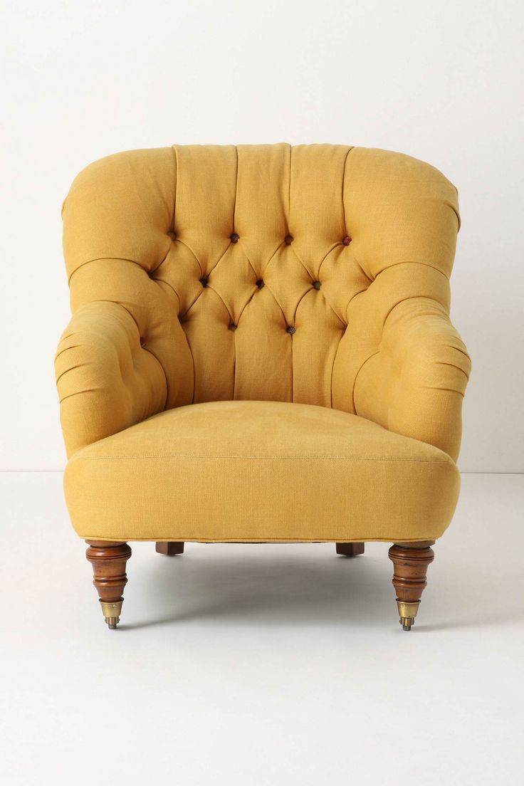 Tufted mustard chair