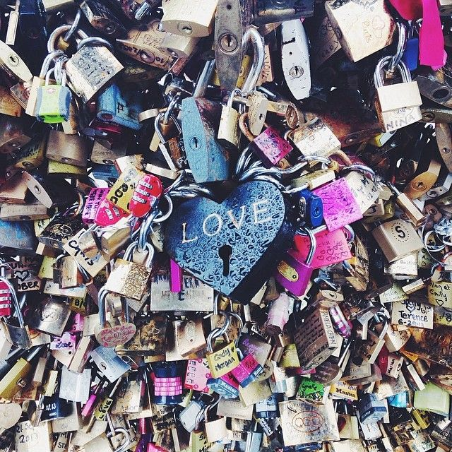 My son and i each put a couple of these on here, i wonder if we will EVER be able to find them if we go  back to Paris?Love locks bridge in Paris