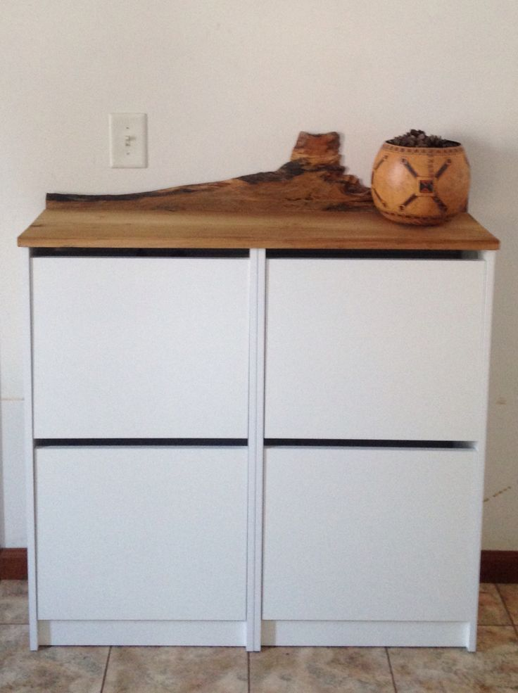 IKEA Bissa hack. We replaced the top of two Bissas shoe cabinets with a reclaimed yellow poplar board and a piece of rough edged spalted sugar maple.