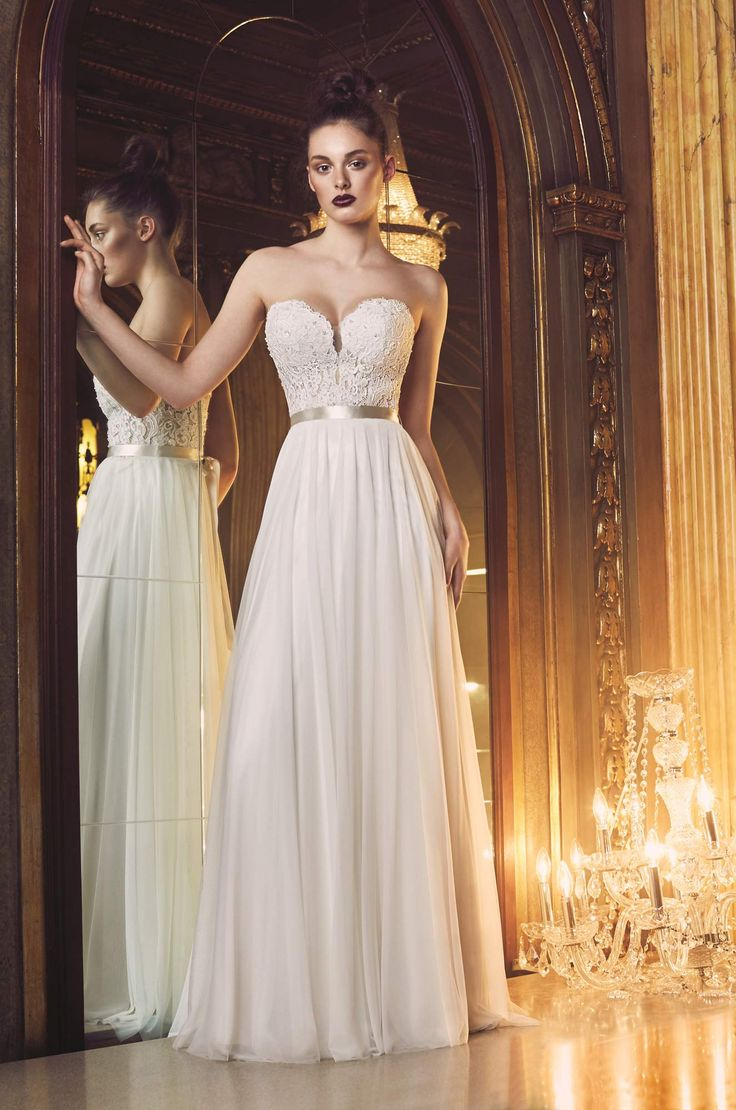 View our Gathered Tulle Wedding Dress - Style #4707 from Paloma Blanca. Strapless beaded lace corset bodice with plunging neckline. Full mesh tulle skirt.