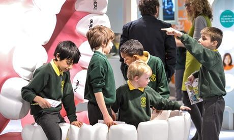 Children from Holy Trinity School in a giant mouth installation at Eureka! children's museum