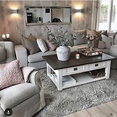 Grey and Pink Living Room Inspiration | Grey Furniture | Pink Accents | White and Brown Coffee Table