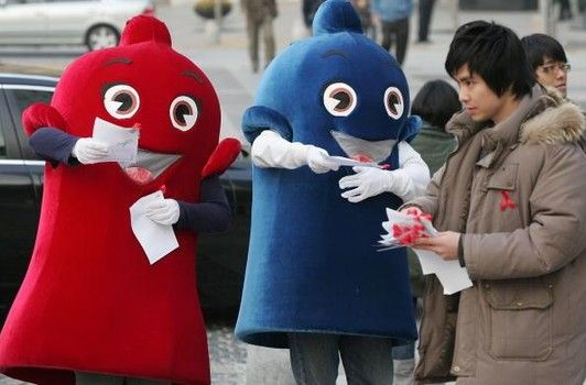 South Koreans dressed in a condom costume spreads awareness at an AIDS awareness campaign in Seoul, South Korea.