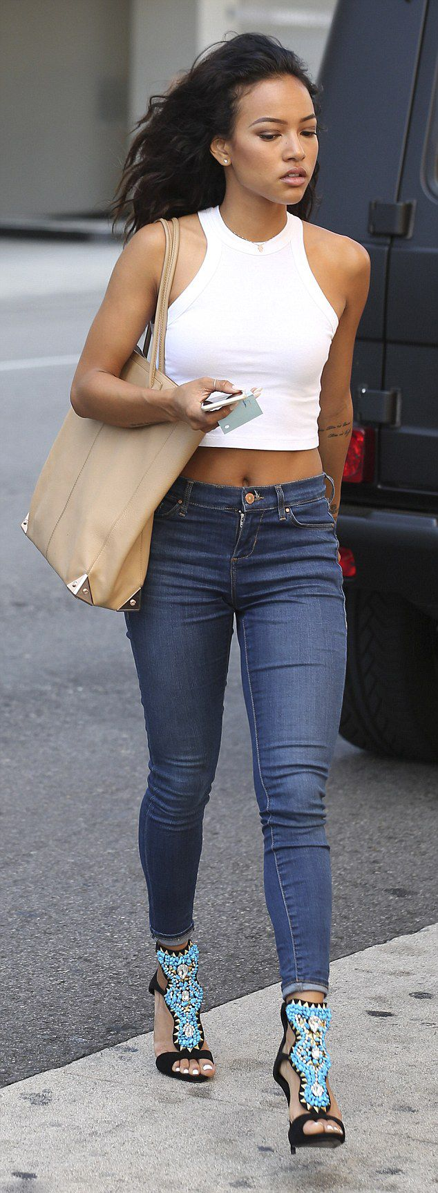 Karrueche-Tran-hit-up-hot-spot-Mr.-Chow-in-a-crop-top-high-waisted-jeans-and-her-favorite-Giuseppe-Zanotti-turquoise-beaded-sandals..jpg (634×1727)