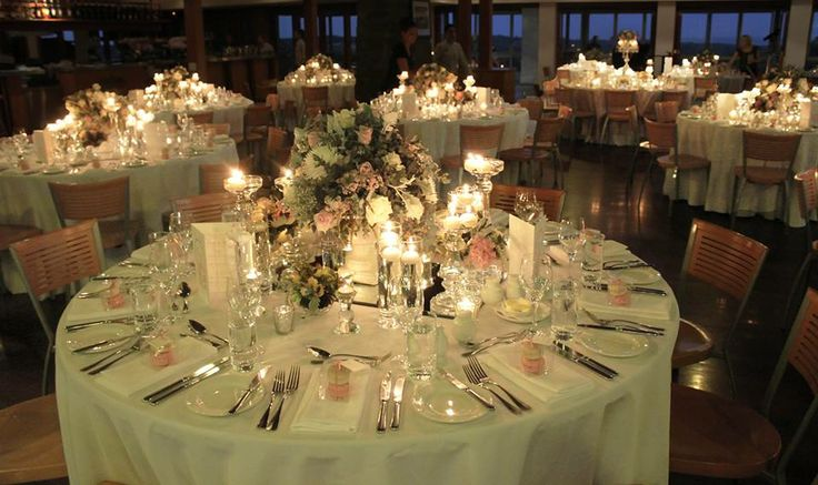 The floor-length-clothed reception tables were floating under a sea of candle light and sweet smelling florals.