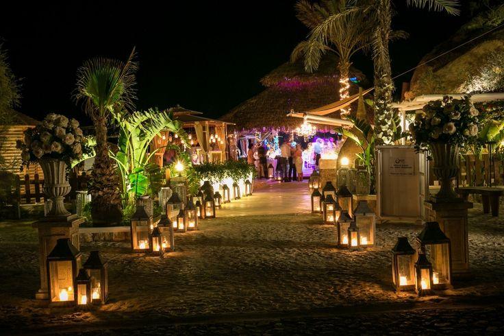 Wedding reception venue: lanterns light up the path to the reception dinner!